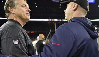 Oakland Raiders head coach Jack Del Rio, left, speaks with Houston Texans head coach Bill O'Brien an AFC Wild Card NFL football game Saturday, Jan. 7, 2017, in Houston. The Houston Texans won 27-14. (AP Photo/Eric Christian Smith)