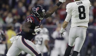 Houston Texans outside linebacker Whitney Mercilus (59) chases Oakland Raiders quarterback Connor Cook (8) during the second half of an AFC Wild Card NFL football game Saturday, Jan. 7, 2017, in Houston. (AP Photo/Eric Gay)