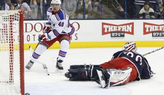 New York Rangers' Michael Grabner, left, of Austria, beats Columbus Blue Jackets' Curtis McElhinney to score the game-winning goal during the third period of an NHL hockey game Saturday, Jan. 7, 2017, in Columbus, Ohio. The Rangers beat the Blue Jackets 5-4. (AP Photo/Jay LaPrete)