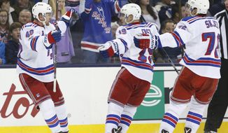 New York Rangers' Michael Grabner, left, of Austria, celebrates his game-winning goal against the Columbus Blue Jackets with teammates Jesper Fast, center, of Sweden, and Brady Skjei during the third period of an NHL hockey game Saturday, Jan. 7, 2017, in Columbus, Ohio. The Rangers beat the Blue Jackets 5-4. (AP Photo/Jay LaPrete)