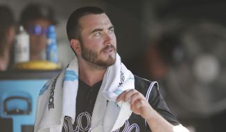 File - In this Monday, Sept. 5, 2016, file photo, Colorado Rockies starting pitcher Chad Bettis is shown in the team's dugout in the eighth inning of a baseball game against the San Francisco Giants in Denver. Always so optimistic, Bettis vowed to be ready for spring training even after being diagnosed with testicular cancer in November and undergoing surgery. Now, he knows for sure: The Colorado Rockies right-hander will most certainly be ready to pitch next month. Cancer-free, too.  (AP Photo/David Zalubowski, File)