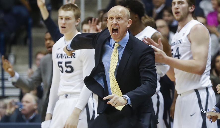 Xavier head coach Chris Mack reacts in the first half an NCAA college basketball game against St. John's, Saturday, Jan. 7, 2017, in Cincinnati. (AP Photo/John Minchillo)