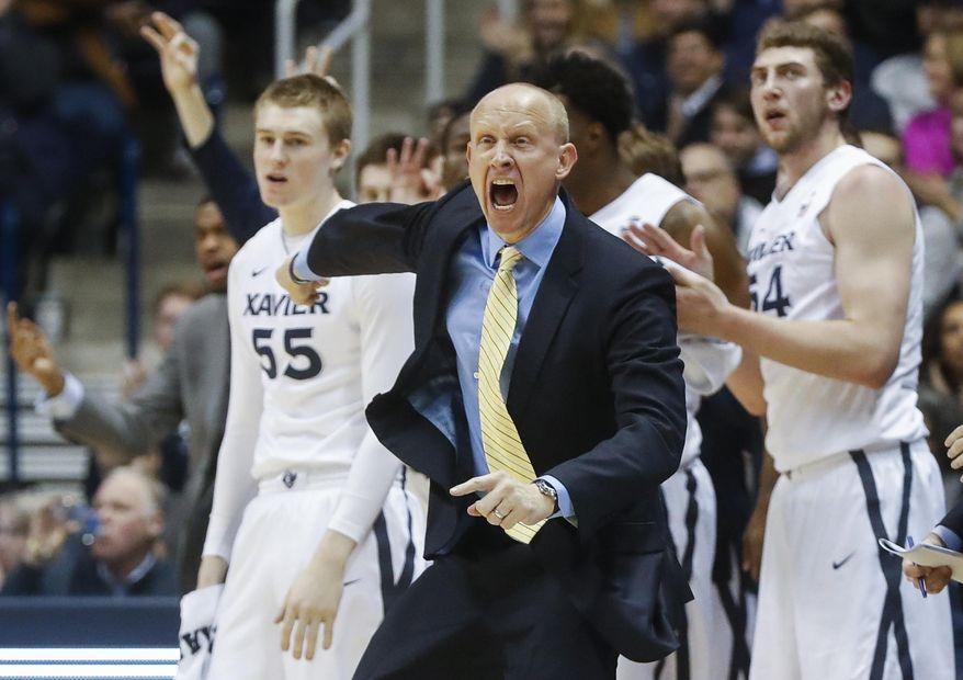 Xavier head coach Chris Mack reacts in the first half an NCAA college basketball game against St. John's, Saturday, Jan. 7, 2017, in Cincinnati. (AP Photo/John Minchillo)