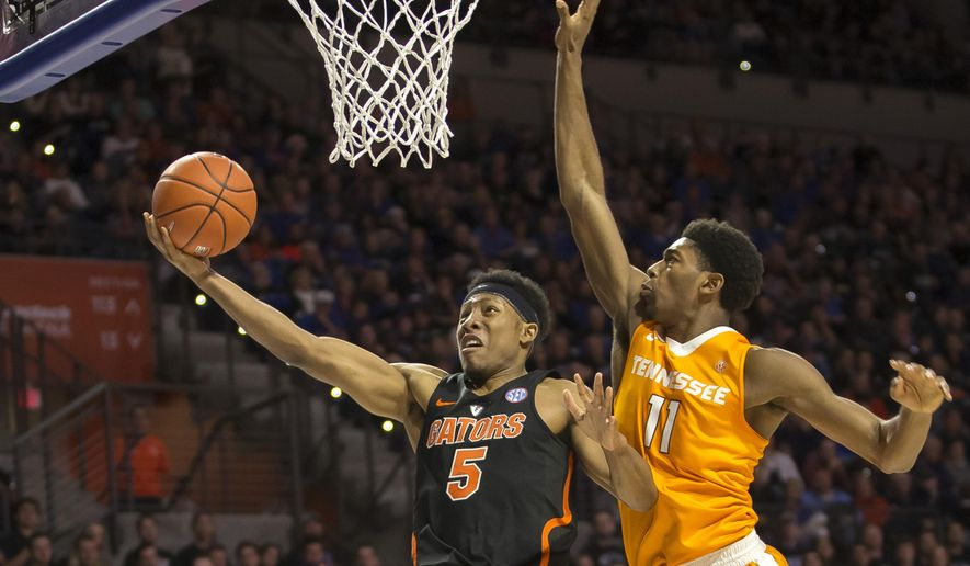 Florida guard KeVaughn Allen (5) shoots a layup past Tennessee forward Kyle Alexander (11) during the first half of an NCAA college basketball game in Gainesville, Fla., Saturday, Jan. 7, 2017. (AP Photo/Ron Irby)