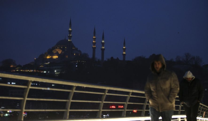 People walk over the Golden Horn Bridge in Istanbul, Friday, Jan. 6, 2017. Turkey's economy is suffering in the face of a string of extremist attacks _ including the nightclub massacre of New Year's revelers, most of them foreigners _ and uncertainty following the failed coup in July against President Recep Tayyip Erdogan that saw more than 270 people killed. AP Photo/ Emrah Gurel)