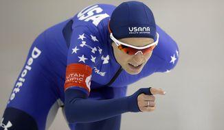 Mia Manganello competes in the women's 5,000 meters U.S. long track speedskating championship, at Utah Olympic Oval, Saturday, Jan. 7, 2017, in Kearns, Utah. (AP Photo/Rick Bowmer)