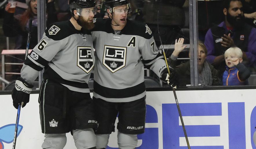 Los Angeles Kings center Jeff Carter, right, celebrates with defenseman Jake Muzzin after scoring during the second period of an NHL hockey game against the Minnesota Wild in Los Angeles, Saturday, Jan. 7, 2017. (AP Photo/Chris Carlson)