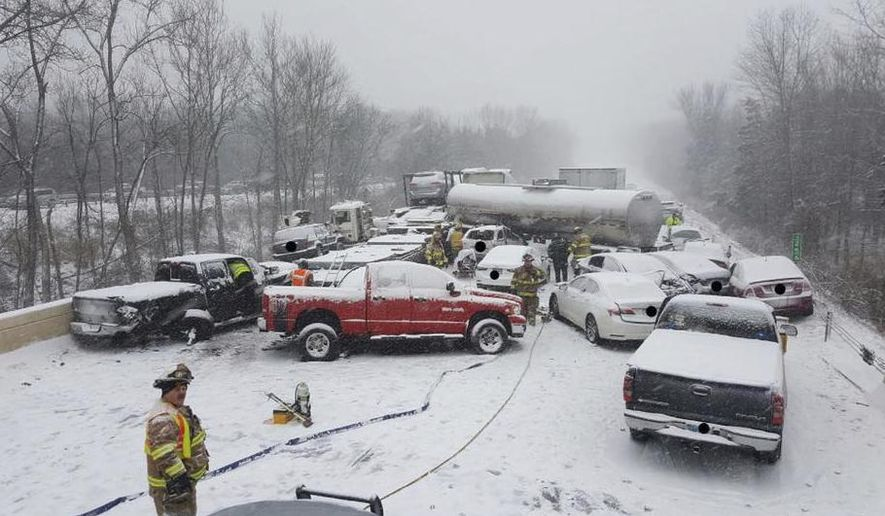 This image provided by the Connecticut State Police shows the scene of a crash involving as many as 20 vehicles on Interstate 91 in Middletown, Conn., on Saturday, Jan. 7, 2017.  No serious injuries were reported. Up to 8 inches of snow was expected in parts of Connecticut, but areas along the southeastern Massachusetts coast could get 1 to 2 feet before the storm moves away later Saturday.  (Connecticut State Police via AP)
