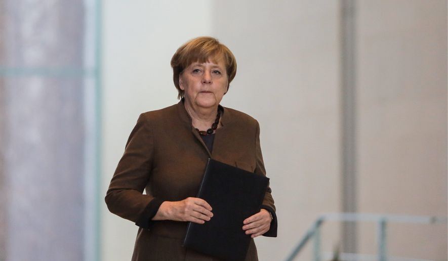 German Chancellor Angela Merkel's Christian Democrats welcomed 945 more members in November, and her coalition partner, the Social Democrats, reported an especially high number after U.S. elections. (Associated Press)