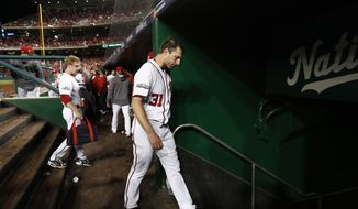Washington Nationals starting pitcher Max Scherzer walks from the dugout during Game 5 of a baseball National League Division Series against the Los Angeles Dodgers at Nationals Park on Thursday, Oct. 13, 2016, in Washington. The Dodgers won 4-3. (AP Photo/Alex Brandon)