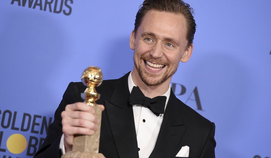 "Tom Hiddleston poses in the press room with the award for best performance by an actor in a limited series or a motion picture made for television for ""The Night Manager"" at the 74th annual Golden Globe Awards at the Beverly Hilton Hotel on Sunday, Jan. 8, 2017, in Beverly Hills, Calif. (Photo by Jordan Strauss/Invision/AP)"