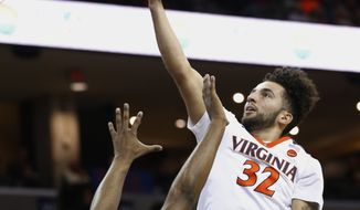 Virginia guard London Perrantes (32) goes up for a shot in front of Wake Forest guard Keyshawn Woods (1) during the first half of an NCAA college basketball game in Charlottesville, Va., Sunday, Jan. 8, 2017. (AP Photo/Steve Helber)