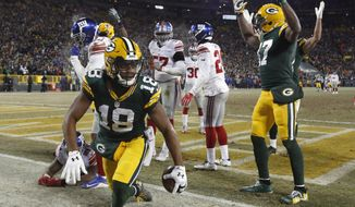 Green Bay Packers wide receiver Randall Cobb (18) celebrates after making a touchdown reception during the first half of an NFC wild-card NFL football game against the New York Giants, Sunday, Jan. 8, 2017, in Green Bay, Wis. (AP Photo/Mike Roemer)