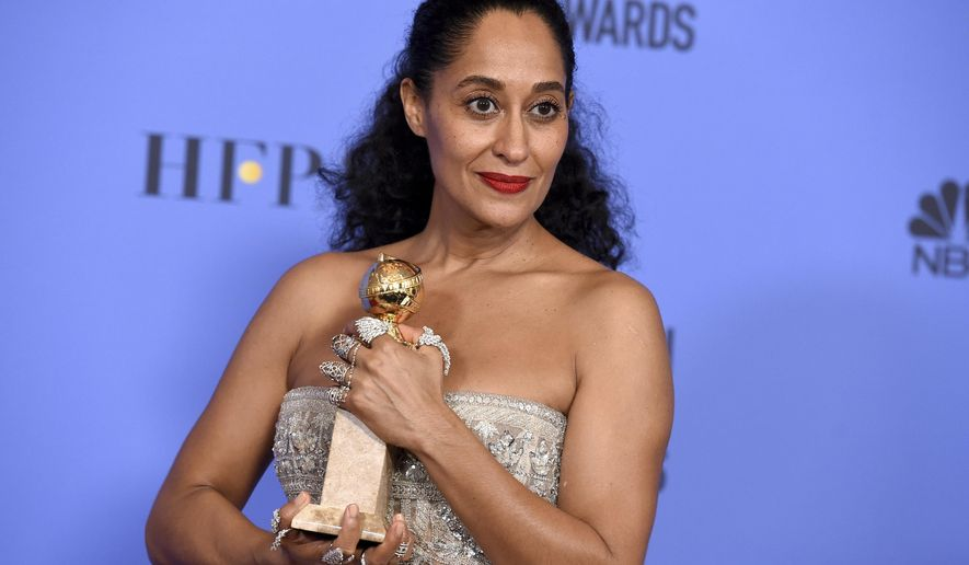 "Tracee Ellis Ross poses in the press room with the award for best performance by an actress in a television series - musical or comedy for ""Black-ish"" at the 74th annual Golden Globe Awards at the Beverly Hilton Hotel on Sunday, Jan. 8, 2017, in Beverly Hills, Calif. (Photo by Jordan Strauss/Invision/AP)"