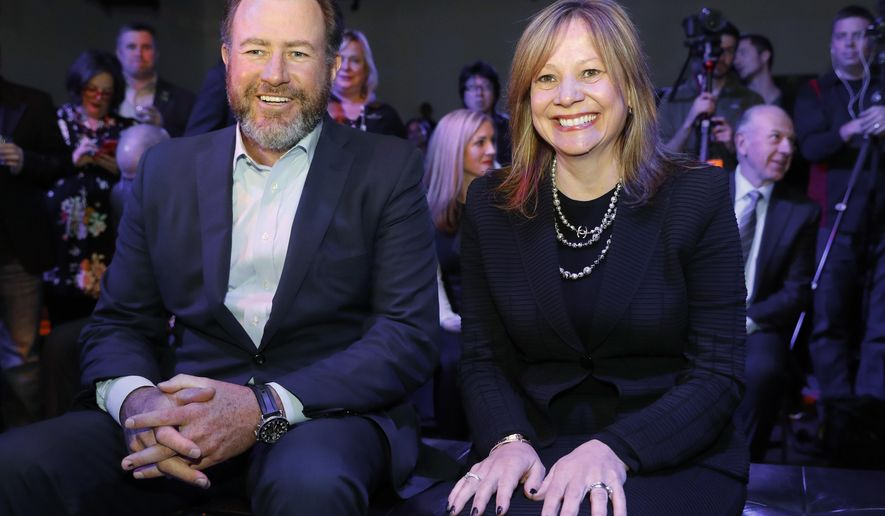 General Motors President Dan Ammann, left, and Chairman and CEO of General Motors  Mary Barra smile before the debut of the 2018 GMC Terrain at the North American International Auto Show in Detroit, Sunday, Jan. 8, 2017. (AP Photo/Paul Sancya)