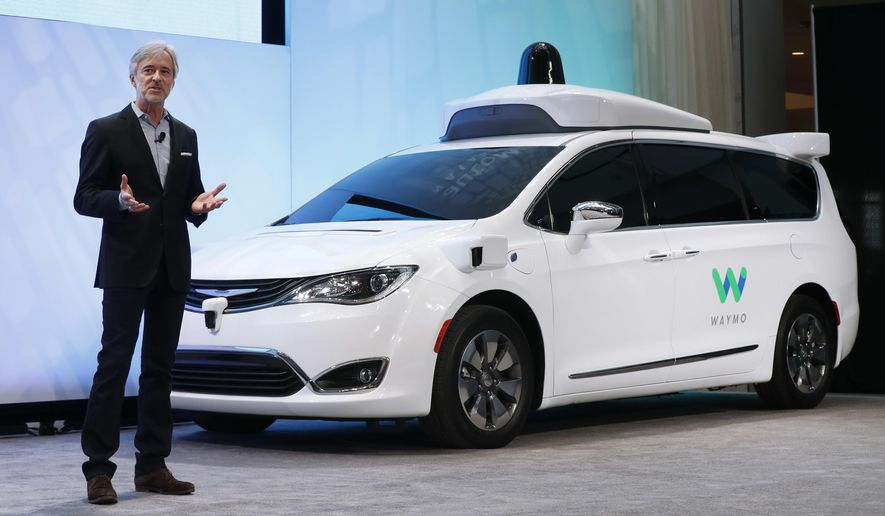 John Krafcik, CEO of Waymo, the autonomous vehicle company created by Google's parent company, Alphabet introduces a Chrysler Pacifica hybrid outfitted with Waymo's own suite of sensors and radar at the North American International Auto Show in Detroit, Sunday, Jan. 8, 2017. (AP Photo/Paul Sancya)