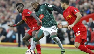 Liverpool's Sheyi Ojo, left, battles for the ball with Plymouth Argyle's Paul Arnold Garita during their FA Cup Third Round soccer match at Anfield, Liverpool, England, Sunday, Jan. 8, 2017. (Martin Rickett/PA via AP)