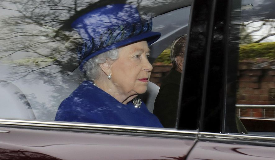 Britain's Queen Elizabeth II in a car with Prince Philip, arrives to attend the morning church service at St. Mary Magdalene Church in Sandringham, England, Sunday Jan. 8, 2017. The 90-year-old British monarch was applauded by well-wishers as she arrived by car at St. Mary Magdalene Church in eastern England. It was her first public appearance in several weeks. (Chris Radburn/PA via AP)
