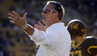 In this Saturday, Oct. 1, 2016, photo, California head coach Sonny Dykes instructs from the sideline during the second half of an NCAA college football game against Utah in Berkeley, Calif. California fired coach Dykes in a surprise move Sunday, Jan. 8, 2017, after four seasons that produced just one bowl appearance. (AP Photo/Marcio Jose Sanchez)