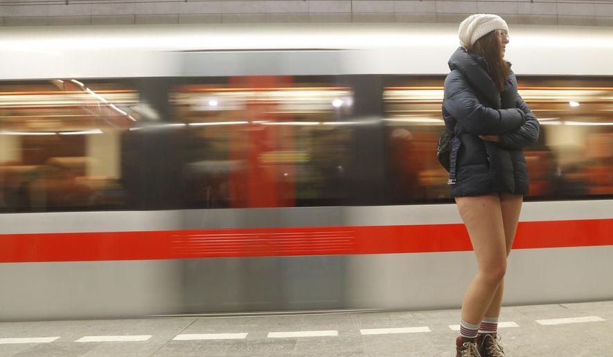 A passenger not wearing pants takes part in the No Pants Subway Ride in Prague, Czech Republic, Sunday, Jan. 8, 2017. The No Pants Subway Ride began in 2002 in New York as a stunt and has taken place in cities around the world since then. (AP Photo/Petr David Josek)