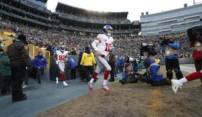 New York Giants quarterback Eli Manning (10) and wide receiver Roger Lewis (82) take the field before an NFC wild-card NFL football game against the Green Bay Packers, Sunday, Jan. 8, 2017, in Green Bay, Wis. (AP Photo/Matt Ludtke)