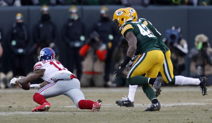 New York Giants wide receiver Odell Beckham (13) drops a pass during the first half of an NFC wild-card NFL football game against the Green Bay Packers, Sunday, Jan. 8, 2017, in Green Bay, Wis. (AP Photo/Matt Ludtke)
