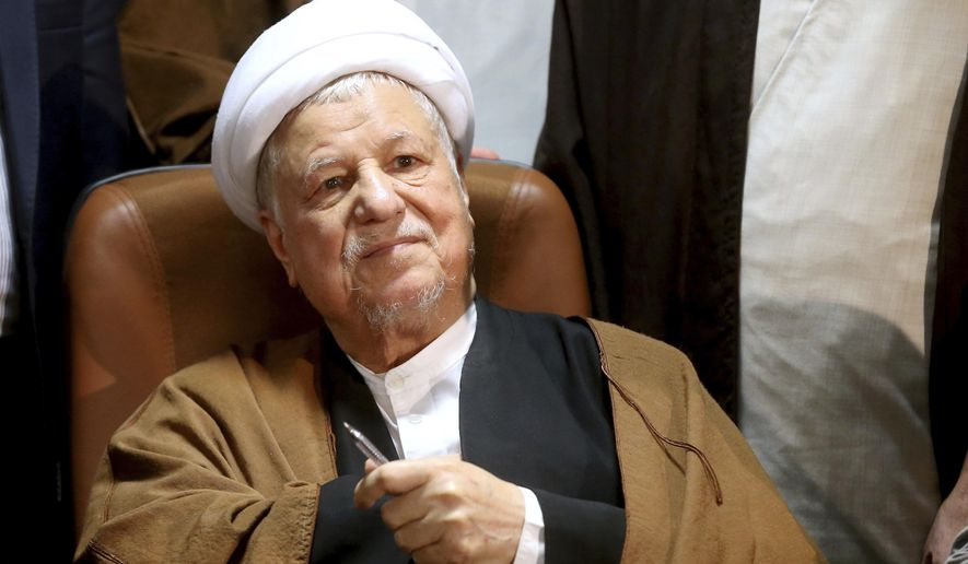 FILE - In this Dec. 21, 2015 file photo, former Iranian President Akbar Hashemi Rafsanjani, registers his candidacy for the elections of the Experts Assembly in Tehran, Iran. Iranian state media said Sunday, Jan. 8, 2017 that influential former President Akbar Hashemi Rafsanjani has died at age 82 after having been hospitalized because of a heart condition. Rafsanjani, who served as president from 1989 to 1997, was a leading politician who often played kingmaker in the country's turbulent politics. He supported President Hassan Rouhani. (AP Photo/Ebrahim Noroozi, File)