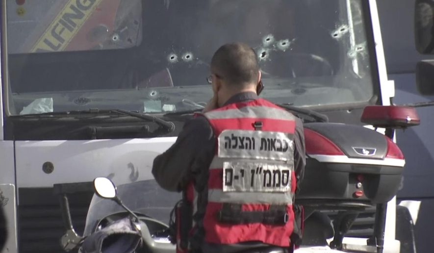 This frame grab from video, shows an Israeli emergency services personnel at scene of a truck-ramming attack in Jerusalem that killed at least four people and wounded several others in Jerusalem, Sunday, Jan. 8, 2017. Israeli police and rescue services said a Palestinian rammed his truck into a group of Israeli soldiers in one of the deadliest attacks of a more than yearlong campaign of violence. Security camera footage shows the truck barreling at a high speed off the road and into the crowd of people in the Armon Hanatziv neighborhood. (AP Photo)
