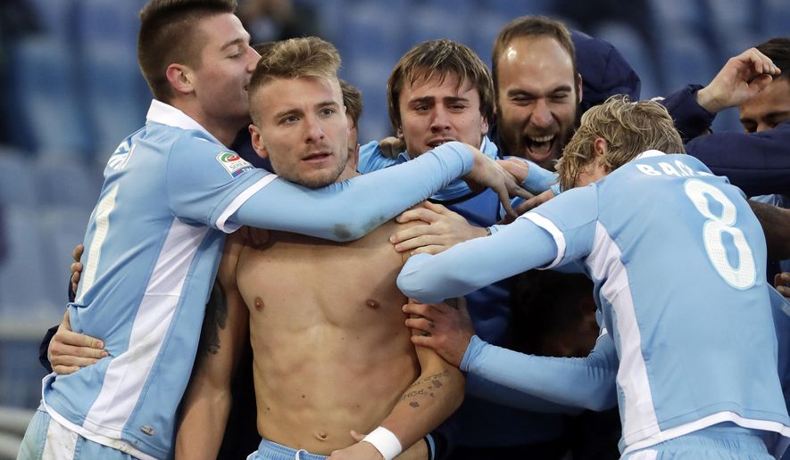 Lazio's Ciro Immobile, second from left, celebrates with his teammates after he scored during a Serie A soccer match between Lazio and Crotone, at Rome's Olympic Stadium, Sunday, Jan. 8, 2017. (AP Photo/Andrew Medichini)