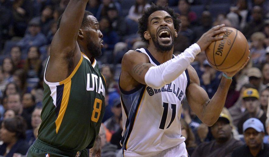 Memphis Grizzlies guard Mike Conley (11) drives against Utah Jazz guard Shelvin Mack (8) in the first half of an NBA basketball game Sunday, Jan. 8, 2017, in Memphis, Tenn. (AP Photo/Brandon Dill)