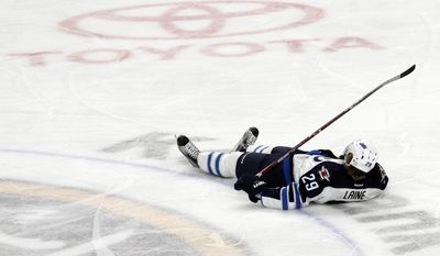 Winnipeg Jets forward Patrik Laine (29) lays on the ice after being hit during the third period of an NHL hockey game against the Buffalo Sabres, Saturday, Jan. 7, 2017, in Buffalo, N.Y. (AP Photo/Jeffrey T. Barnes)