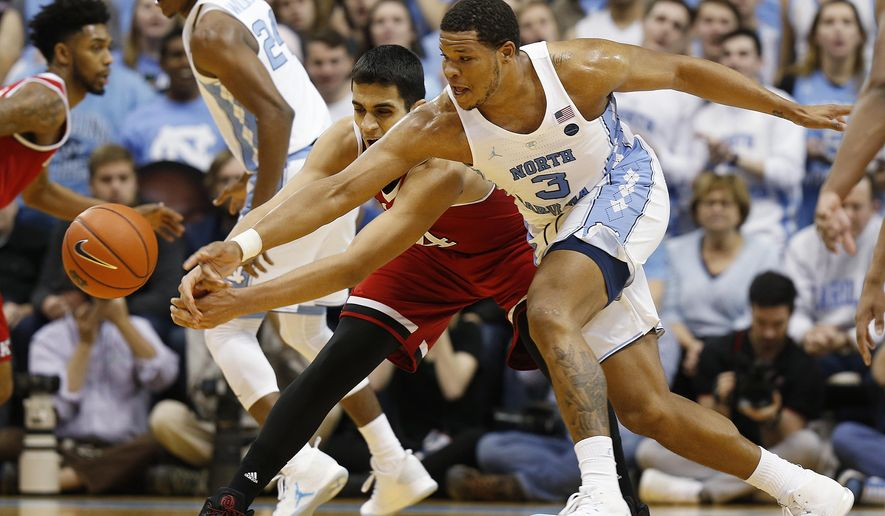 North Carolina forward Kennedy Meeks (3) steals the ball from North Carolina State center Omer Yurtseven (14) during the first half of an NCAA college basketball game Sunday, Jan. 8, 2017, in Chapel Hill, N.C. (AP Photo/Ellen Ozier)