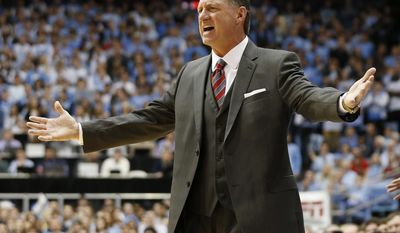 North Carolina State head coach Mark Gottfried reacts during the first half of an NCAA college basketball game against North Carolina, Sunday, Jan. 8, 2017, in Chapel Hill, N.C. (AP Photo/Ellen Ozier)