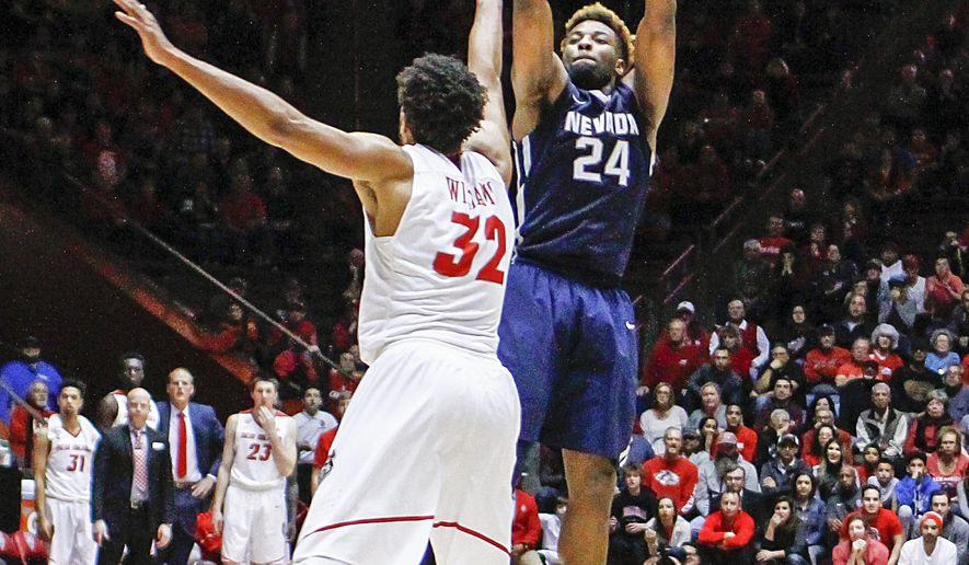 Nevada's Jordan Caroline (24) shoots a 3-pointer over New Mexico's Tim Williams (32) during the second half of an NCAA college basketball game in Albuquerque, N.M., Saturday, Jan. 7, 2017. Nevada won in overtime 105-104. (AP Photo/Juan Antonio Labreche)
