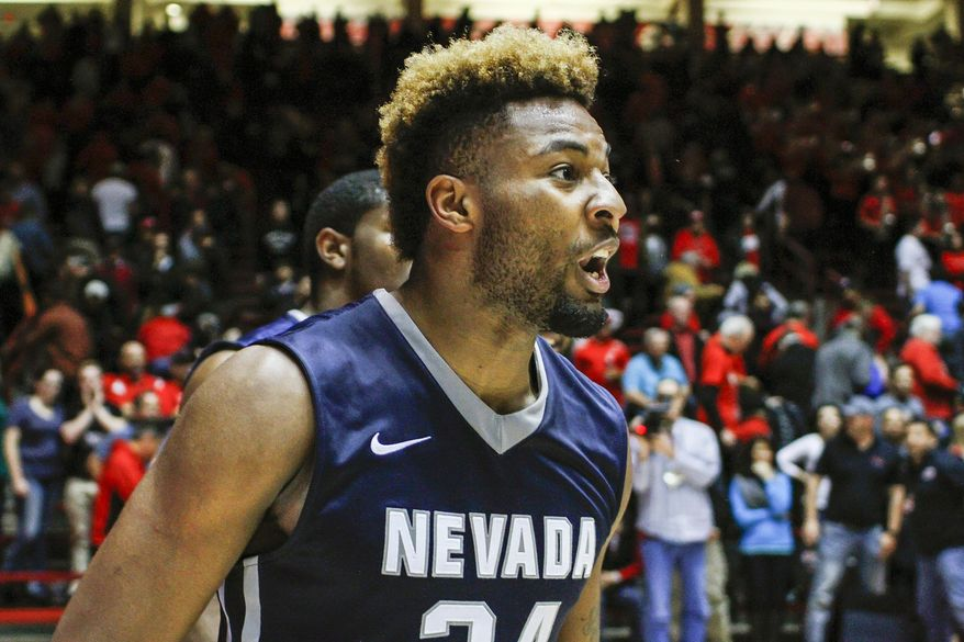 Nevada's Jordan Caroline (24) celebrates his team's win following the end of an NCAA college basketball game against New Mexico in Albuquerque, N.M., Saturday, Jan. 7, 2017. Nevada won in overtime 105-104. (AP Photo/Juan Antonio Labreche)