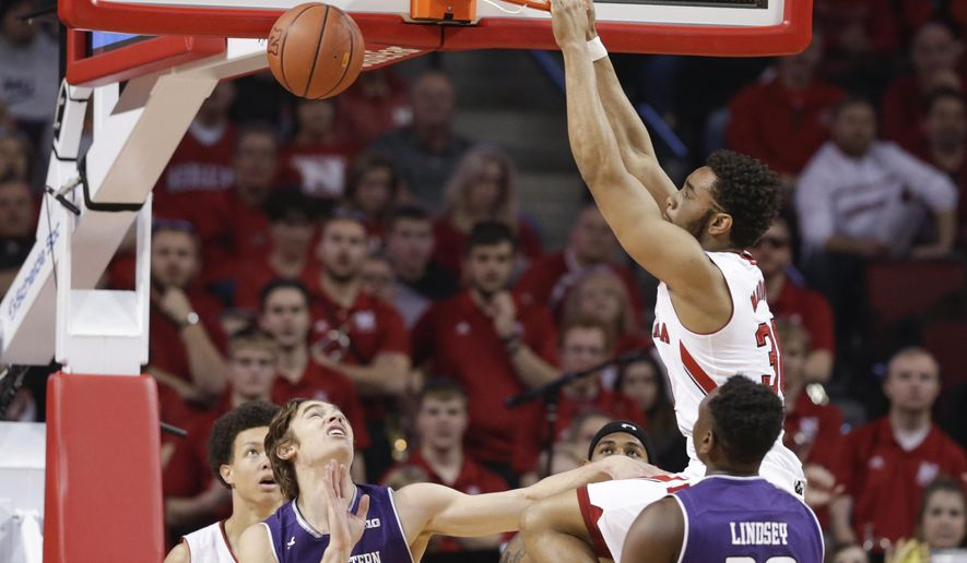 Nebraska's Ed Morrow (30) dunks as Northwestern's Scottie Lindsey (20) and Gavin Skelly (44) watch during the first half of an NCAA college basketball game in Lincoln, Neb., Sunday, Jan. 8, 2017. (AP Photo/Nati Harnik)
