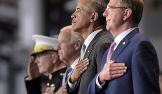 President Obama, stands with, from left, Joint Chiefs Chairman Gen. Joseph Dunford, Vice President Joe Biden, and Defense Secretary Ash Carter, as they listen to the National Anthem during an Armed Forces Full Honor Farewell Review for the president, Wednesday, Jan. 4, 2017, at Conmy Hall, Joint Base Myer-Henderson Hall, Va. (AP Photo/Susan Walsh)