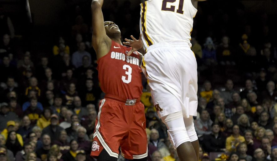 Minnesota center Bakary Konate (21) blocks a shot by Ohio State guard C.J. Jackson (3) during the first half of an NCAA college basketball game Sunday, Jan. 8, 2017, in Minneapolis. (AP Photo/Hannah Foslien)