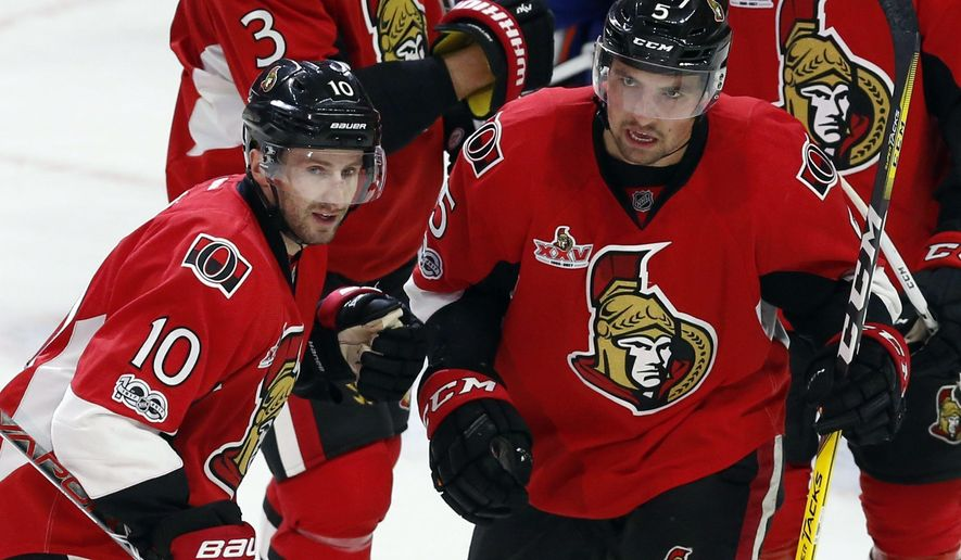 Ottawa Senators left wing Tom Pyatt (10) celebrates his goal against the Edmonton Oilers with teammate defenseman Cody Ceci (5) during the second period of an NHL hockey game in Ottawa on Sunday, Jan. 8, 2017. (Fred Chartrand/The Canadian Press via AP)