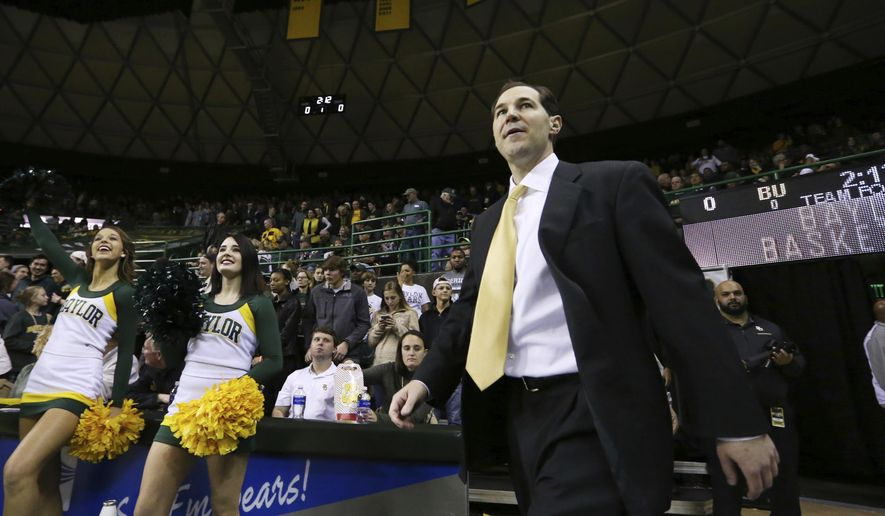 Baylor head coach Scott Drew enters the Ferrell Center before an NCAA college basketball game against Oklahoma State, Saturday, Jan. 7, 2017, in Waco, Texas. (AP Photo/Rod Aydelotte)
