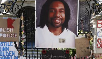 FILE - In this July 25, 2016, file photo, a memorial including a photo of Philando Castile is attached to the gate to the governor's residence where protesters demonstrated in St. Paul, Minn., against the July 6 shooting death of Castile by St. Anthony police Officer Jeronimo Yanez during a traffic stop in Falcon Heights, Minn. A federal agency will be getting input from the public as it reviews a Minnesota police department after the July shooting death of Castile. (AP Photo/Jim Mone, File)