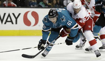 San Jose Sharks' Justin Braun (61) defends on Detroit Red Wings' Steve Ott (29) during the first period of an NHL hockey game Saturday, Jan. 7, 2017, in San Jose, Calif. (AP Photo/Marcio Jose Sanchez)