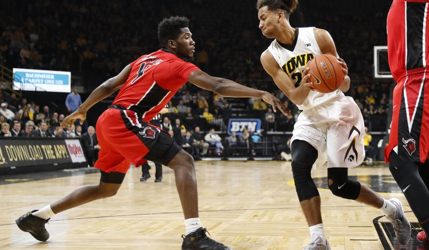 Iowa forward Dom Uhl, right, grabs a rebound in front of Rutgers forward Jonathan Laurent, left, during the first half of an NCAA college basketball game, Sunday, Jan. 8, 2017, in Iowa City, Iowa. (AP Photo/Charlie Neibergall)