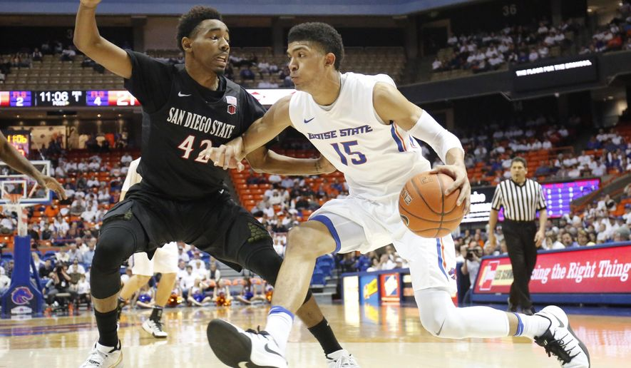 Boise State's Chandler Hutchison (15) moves the ball against San Diego State's Jeremy Hemsley (42) during the first half of an NCAA college basketball game in Boise, Idaho, Saturday, Jan. 7, 2017. (AP Photo/Otto Kitsinger)