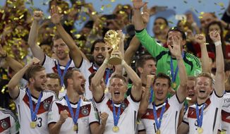 In this July 13, 2014, file photo Germany's Bastian Schweinsteiger holds up the World Cup trophy as the team celebrates their 1-0 victor over Argentina after the World Cup final soccer match between Germany and Argentina at the Maracana Stadium in Rio de Janeiro, Brazil. FIFA is about to make the World Cup a bigger and, it hopes, richer event even at the cost of lower quality soccer. FIFA President Gianni Infantino hopes his ruling Council will agree Tuesday, Jan. 10, 2017, to expand the 2026 World Cup to 48 nations, playing in 16 groups of three teams. (AP Photo/Natacha Pisarenko, file)