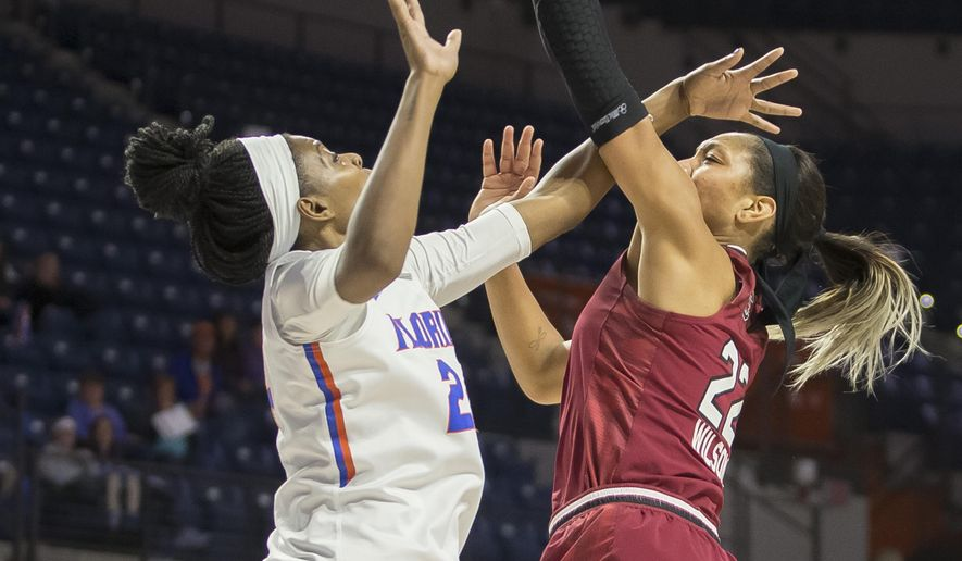 South Carolina forward A'ja Wilson (22) is fouled on this shot attempt by Florida center Tyshara Fleming, left, during the first half of an NCAA college basketball game in Gainesville, Fla. on Sunday, Jan. 8, 2017. (AP Photo/Ron Irby)