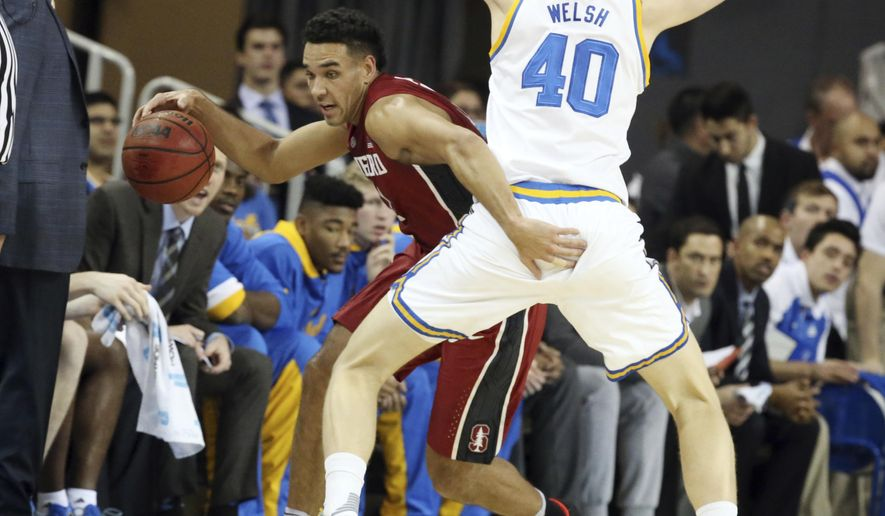 UCLA center Thomas Welsh (40) defends as Stanford guard Dorian Pickens tries to go around n the first half of an NCAA college basketball game in Los Angeles on Sunday, Jan. 8, 2017. (AP Photo/Reed Saxon)