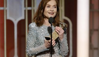 "This image released by NBC shows Isabelle Huppert accepting the award for best actress in a motion picture drama for her role in ""Elle"" at the 74th Annual Golden Globe Awards at the Beverly Hilton Hotel in Beverly Hills, Calif., on Sunday, Jan. 8, 2017. (Paul Drinkwater/NBC via AP)"