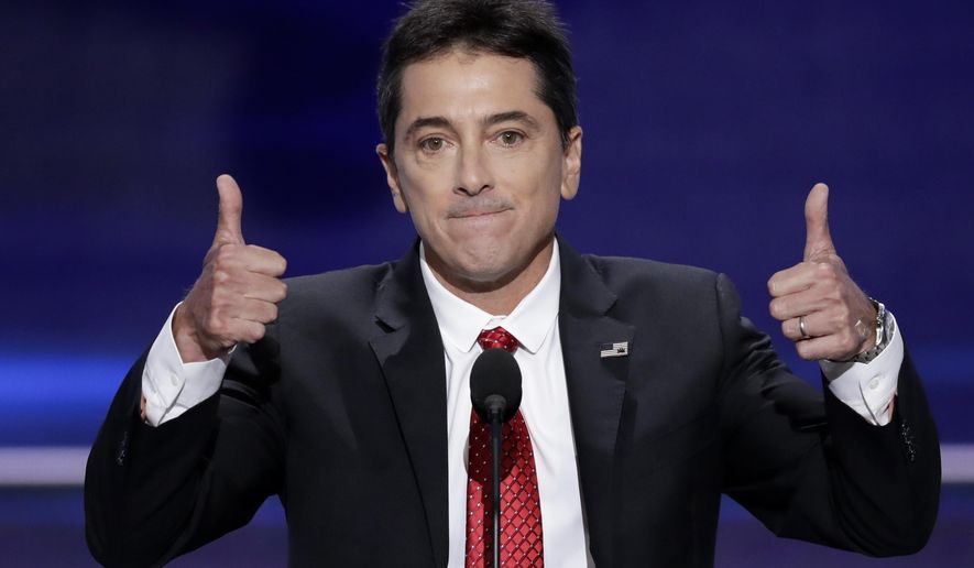 In this July 18, 2016 file photo, actor Scott Baio gives two thumbs up after addressing the delegates during the opening day of the Republican National Convention in Cleveland. (AP Photo/J. Scott Applewhite, File)