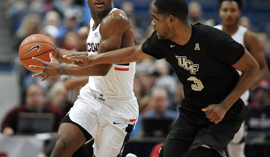 Connecticut's Rodney Purvis dribbles around Central Florida's A.J. Davis, right, in the first half of an NCAA college basketball game, Sunday, Jan. 8, 2017, in Hartford, Conn. (AP Photo/Jessica Hill)